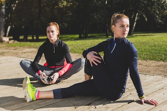Flexible woman doing warm-ups before starting to run