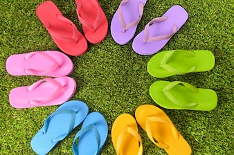 Flip flops collection over the grass