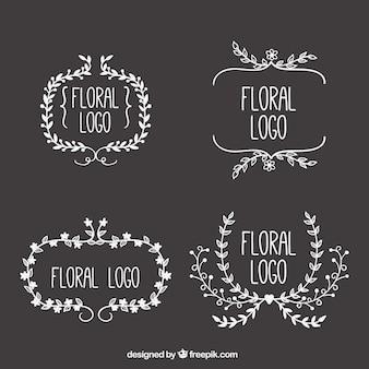 Floral frame logos on blackboard