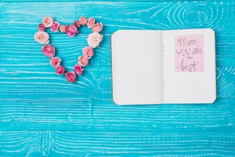 Floral ornament and open notebook for mother's day
