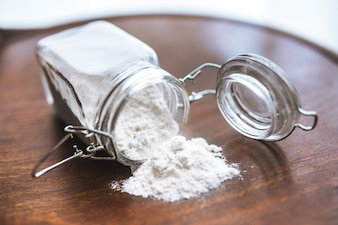 Flour on the table and in a glass jar