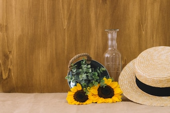 Flower composition with bucket and hat