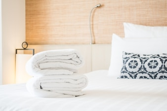 Folded towels on a bed