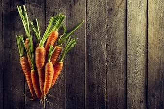 Food Organic Vegetable Colorful Background. Tasty Fresh Carrots on Wooden Table. Top View with Copy Space. Healthy Life Concept.