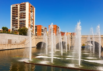 Fountains and bridge over Manzanares river in  Madrid