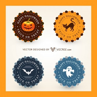 Four halloween badges with symbols