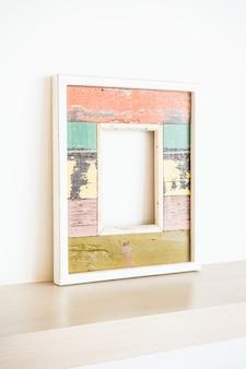 Frame reflected in a desk
