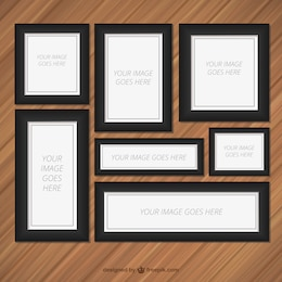 Frames set on wood wall
