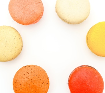 French colorful macarons on white background .