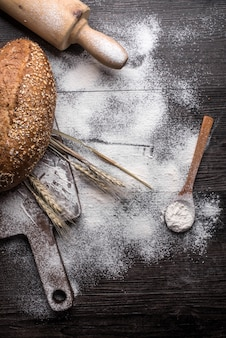 Fresh bread on a wooden background
