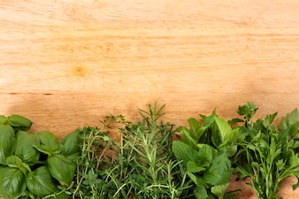 Fresh herbs on wooden board
