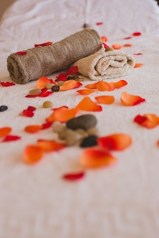 Fresh petals and stones with towels