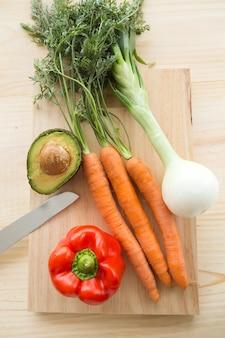 Fresh vegetables under wood background.