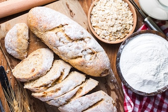 Freshly baked traditional bread on wooden table Oatmeal Bread