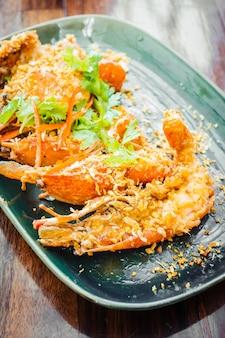 Fried prawn with garlic in plate