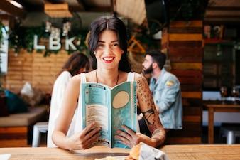 Friendly woman with menu
