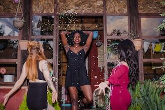 Friends dancing under confetti