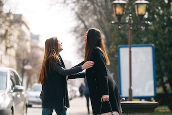 Friends greet each other on the street