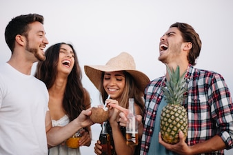 Friends laughing at a beach party