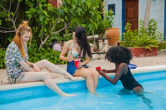 Friends laughing at swimming pool party