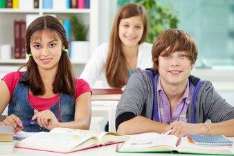 Friends sitting in class