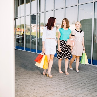 Friends talking after shopping