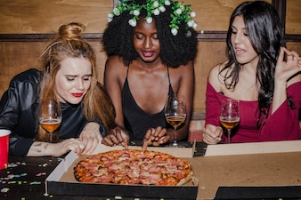 Friends with hunger of pizza