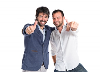 Friends with thumb up over white background