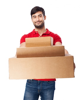 Front view of boy with boxes on white background