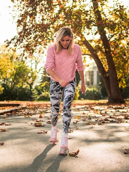 Front of woman in legging roller skating