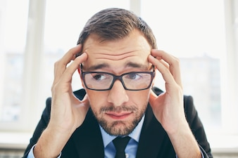 Frustrated businessman with glasses
