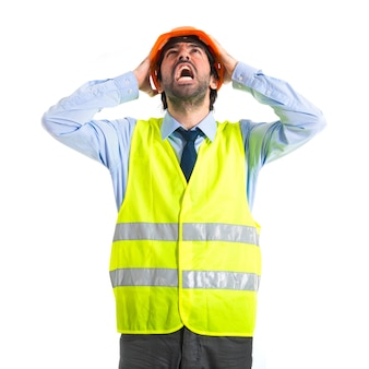 Frustrated workman over white background