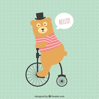 Funny bear riding a bycicle