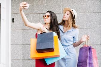 Funny women taking selfies