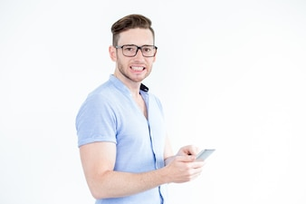 Funny young man with smartphone clenching teeth