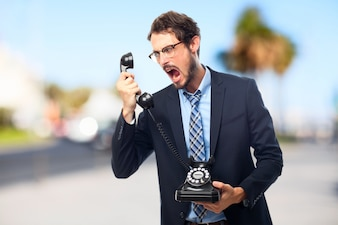 Furious businessman screaming on the phone