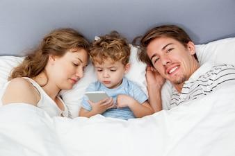 Gadget son bed togetherness parenthood
