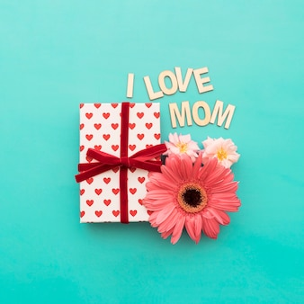 Gift box, flowers and  i love mom  lettering close up