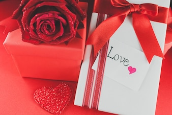 Gift boxes with chocolates and a love note