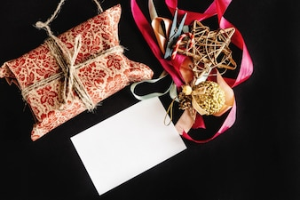 Gift package, christmas decorations and a white paper