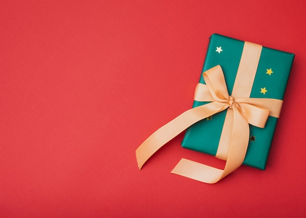 Gift with golden stars for christmas with copy space