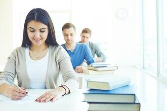 Girl and boy doing an exam