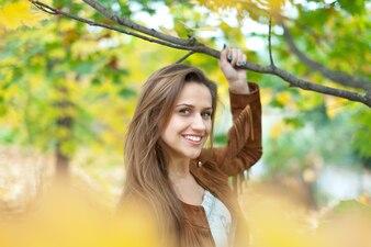 Girl at autumn park