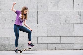 Girl balancing on a skateboard