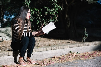 Girl concentrated on reading book