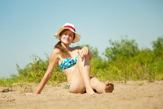 Girl enjoying the sandbeach