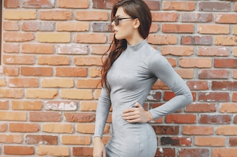 Girl fashion brick wall
