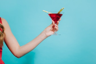 Girl holding cocktail