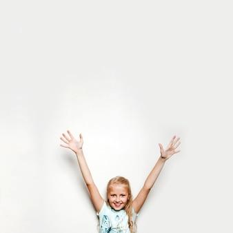 Girl holding hands up smiling
