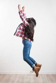 Girl jumping on her side with outstretched arms